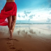 Woman walks towards the ocean